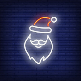 Neon Santa Claus shape. Festive element. Christmas concept for night bright advertisement