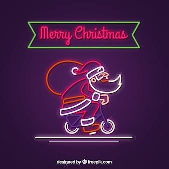 Babbo natale al neon con la bicicletta