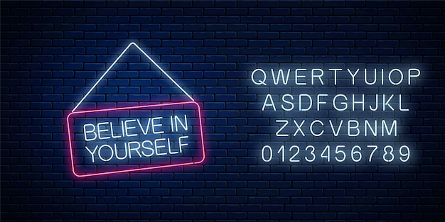 Neon sign of believe in yourself inscription on hanging board with alphabet.
