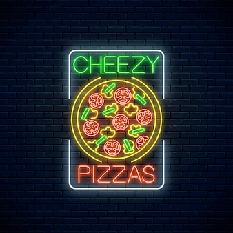 Neon sign of cheezy pizza with tomatoes and cheese in rectangle frame on a dark brick wall background.