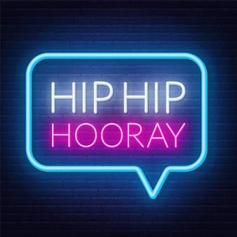 Neon sign hip hip hooray in frame on dark background.