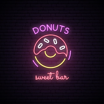 Neon sign of sweet donuts.