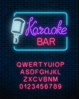 Neon signboard of karaoke music bar with alphabet.