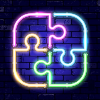 Neon signboard puzzle jigsaw. concept teamwork, collaboration. bright night signboard on brick wall sign.   realistic neon icon