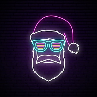 Neon signboard with santa claus portrait.