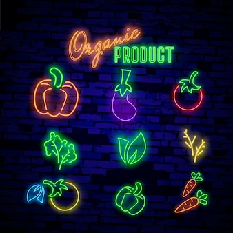 Neon signs vegetables the symbols of different vegetables on a dark background.