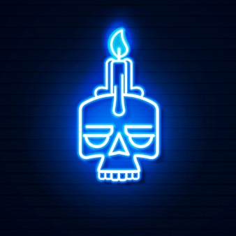 Neon skull with candle on brick wall