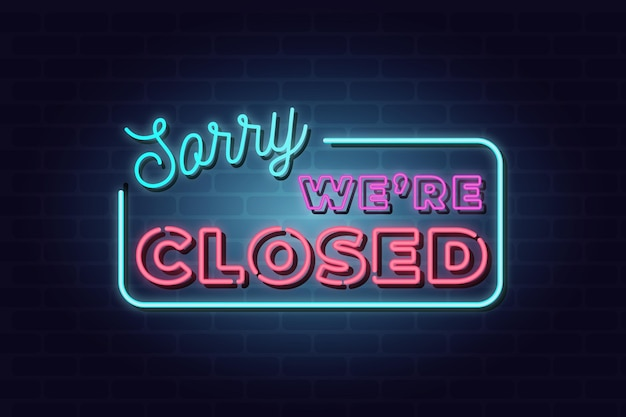 Neon 'sorry we are closed' sign on brick wall Premium Vector