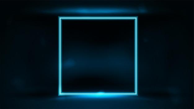 暗いぼやけた背景の暗い部屋のネオンの正方形の青いフレーム