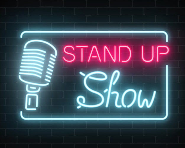 Neon stand up show sign with retro microphone on a brick wall