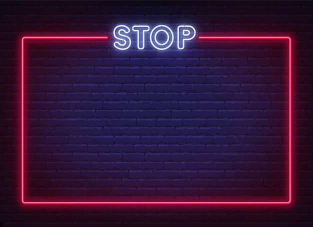 Neon stop sign in a frame on brick wall background. prohibition template .