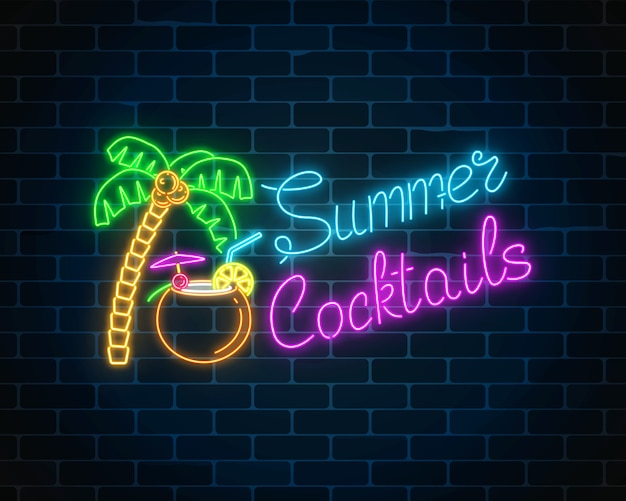 Neon summer cocktail bar sign on dark brick wall background. glowing gas advertising with shake in coconut