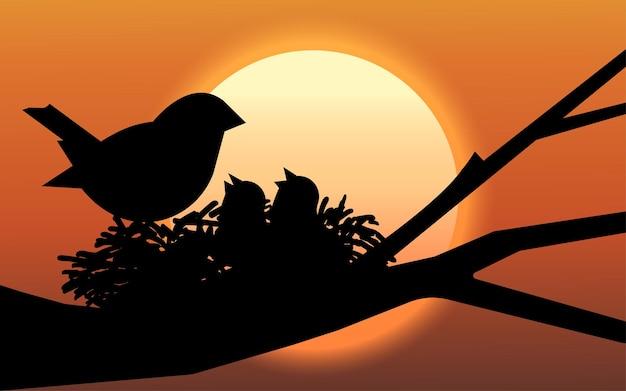 日没のイラストで木の枝に鳥の巣