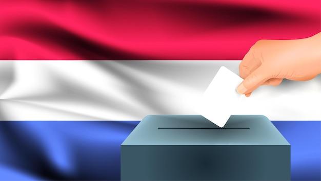 Флаг нидерландов, мужская рука голосование с фоном идеи концепции флага нидерландов