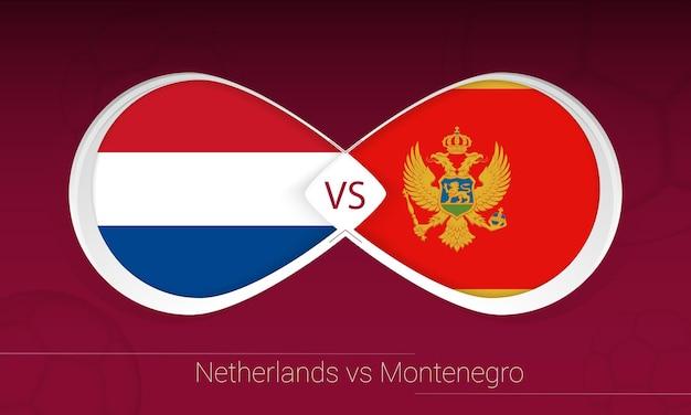 Нидерланды против черногории в футбольном соревновании, группа g. versus значок на футбольном фоне.