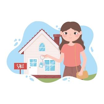 新しい家、家の上に立っている鍵を持つ不動産業者
