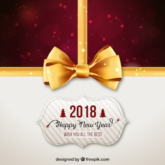 New year 2018 background with golden bow