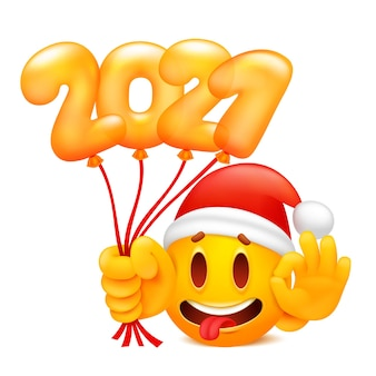 New year 2021 sticker with yellow cartoon emoji character in santa claus hat.