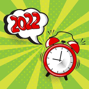 New year 2022 vector comic alarm clock with speech bubble on green background. comic sound effect, stars and halftone dots shadow in pop art style. holiday
