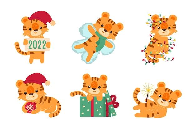 Новый год и рождество с милыми маленькими тиграми. герои мультфильмов для наклеек.