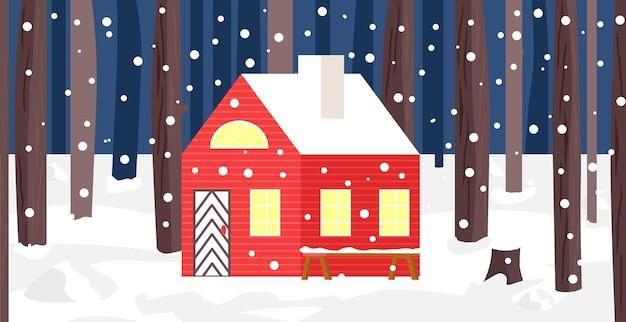 森の中の新年とクリスマスの冬の家木の風景に囲まれた明るい建物
