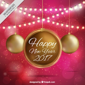 New year background of golden christmas balls and string lights