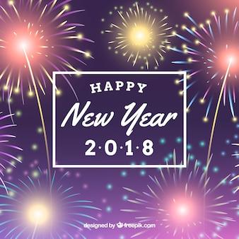カラフルなネオンの花火と新年の背景