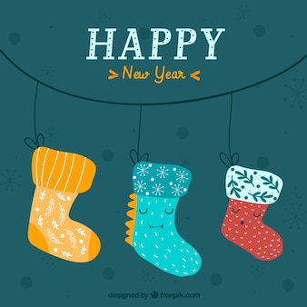 New year background with cute hand drawn socks
