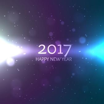 Lucido 2017 felice nuovo sfondo year design con striature di luce