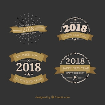New year badges with beige ribbons