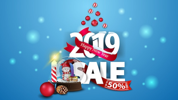 New year blue discount banner with large numbers 2019, snow globe and candle