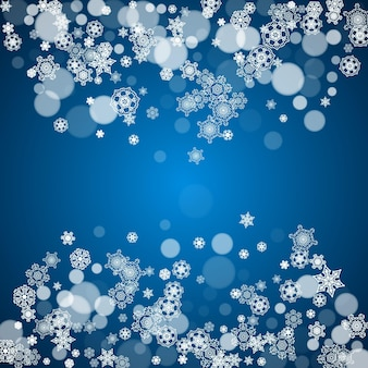 New year frame with cold snowflakes on blue background. winter window. christmas and new year frame for gift certificates, ads, banners, flyers, sales offers, event invitations. falling snow and bokeh