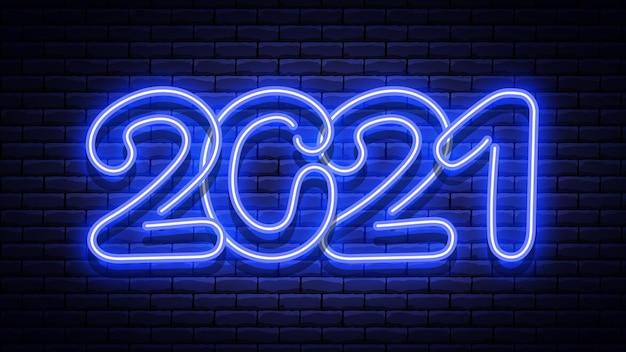 Новогодняя светящаяся синяя неоновая вывеска на кирпичной стене