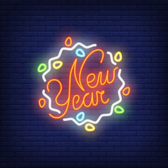 New year neon sign with garland. christmas concept for night bright advertisement.