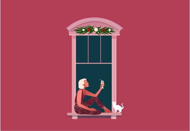 새해 또는 크리스마스 축하. 폐쇄. 검역 생활. 창에 앉아서 칵테일을 마시는 여자.
