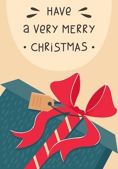 Новогодняя открытка с рождественским подарком с красным бантом. новогодняя открытка.