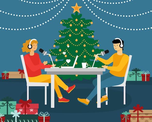 새해 팟캐스트. 남자와 여자는 테이블에 앉아서 마이크에 대고 말한다