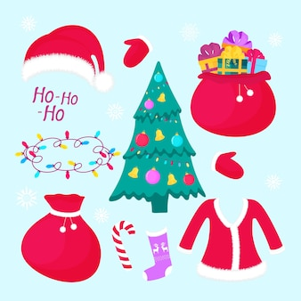 New years decorations christmas fir tree with balls a bag with presents santa claus costume and hat