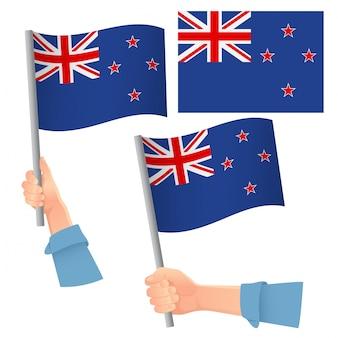 Флаг новой зеландии в руке