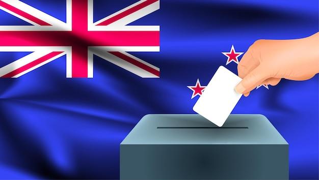 Флаг новой зеландии, мужская рука голосование с фоном идеи концепции флага новой зеландии