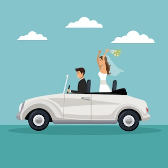 Newly married couple driving in a car