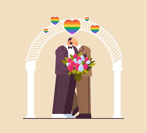 結婚式のアーチトランスジェンダーの愛lgbtコミュニティの結婚式のお祝いの近くでキスする花と新婚の同性愛者のカップル