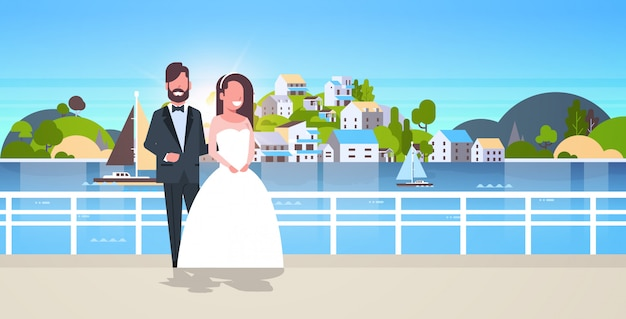 Newlyweds man woman standing together romantic couple bride and groom embracing wedding day concept mountain city island landscape background horizontal