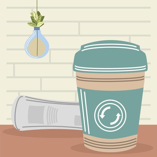 재활용 컵이 있는 신문