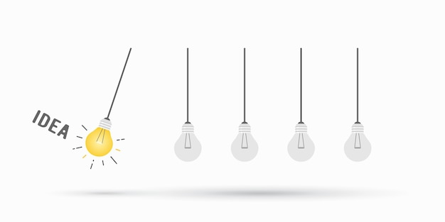 Newton's cradle concept with lightbulb