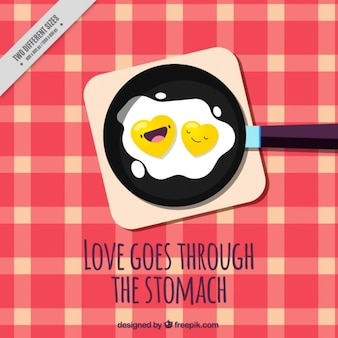 Nice background of fried eggs in a pan with loving phrase