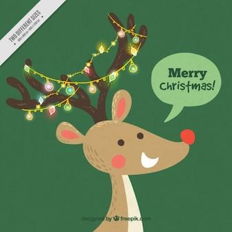 ライトとメリークリスマスメッセージニーストナカイの背景