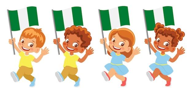 Nigeria flag in hand. children holding flag. national flag of nigeria