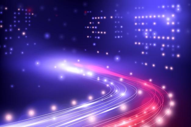 고층 빌딩으로 둘러싸인 자동차 조명으로 빛나는 고속도로를 볼 수있는 야간 도시 조명 구성