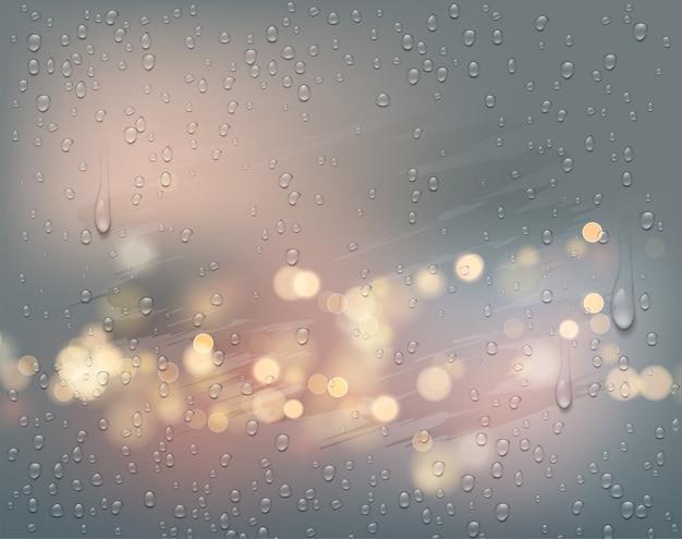 Ночной город огней вид через туманное окно с каплями дождя.
